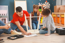 Family Assembling Furniture At...