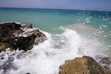 Waves Crashing On A Rocky Shore In The Tropics