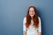 Fun loving happy young woman standing laughing