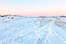 Dirt Road Along A Snowy Field ...