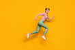 Full length photo of pretty lady jumping high rushing low prices sales shopping center wear red white pullover shirt green pants footwear isolated bright yellow background