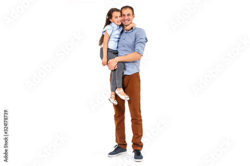 Valokuvatapetti Girl hugging her father - isolated over a white background