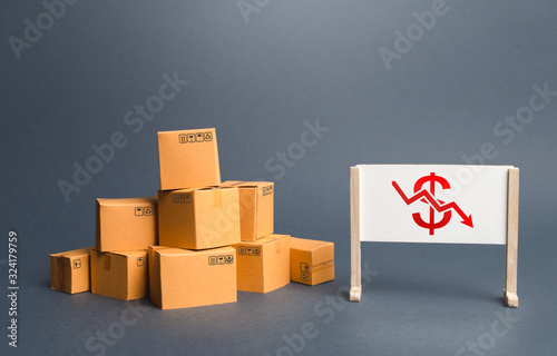 Pile of boxes and easel with red dollar arrow down chart Wallpaper Mural