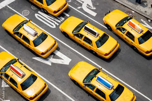 Vászonkép View from above of fleet of yellow taxi cabs driving down the street of Broadway