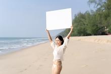 Woman In Bikinis Holding Blank...