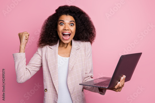 Valokuvatapetti Photo of crazy excited dark skin lady open mouth hold notebook raise fist ecstat
