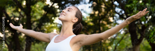 Photo BANNER of healthy happy young woman in park, arm opening for city nature sanctua