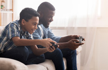 Afro Father And Son Playing Vi...