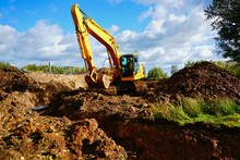 Excavator Digging Ground Const...