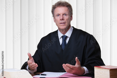 Fotografia Judge or lawyer at his desk in a bright courtroom