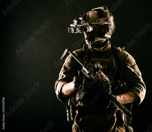 Cuadros en Lienzo Army elite soldier with hidden behind mask and glasses face, in full tactical am
