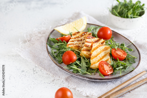 fresh salad with grilled halumi cheese, cherry tomatoes and arugula Canvas Print
