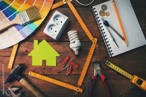 Fototapeta home improvement and repair concept - work tools and objects on wooden table. top view obraz