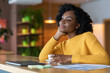 Relaxed afro girl enjoying cup of coffee during lunch break