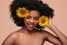 Happy Bare Shouldered Woman With Sunflowers On Pink Background