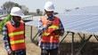 Engineers and workers are reporting work plans and checking the solar farms.