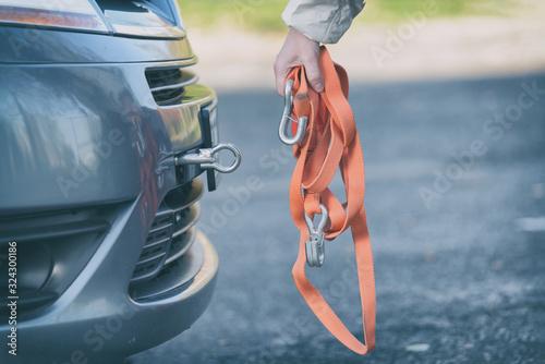 woman assembling towing hook to a broken car Tapéta, Fotótapéta