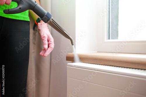 Fototapeta Employee cleaning service processes steam heating radiator obraz