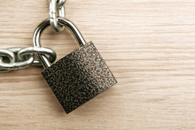 Durable Padlock With A Steel Chain On A Wooden Background Security Service