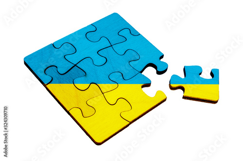 Wooden puzzles with ukraine flag, divided puzzle pieces on white isolated background Canvas Print