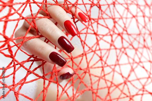 Fototapeta Fashionable red nail Polish color from light to dark on a rectangular shape