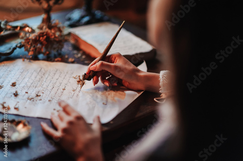 Girl writes a letter with an antique fountain pen Wallpaper Mural