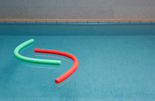 Aqua Noodles Floating On Water Of Indoor Swimming Pool