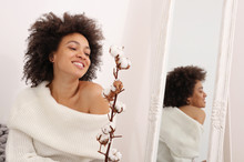 Happy Woman With Afro Hairstyl...