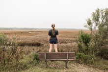 Teenage Girl Standing On A Bench Looking Out Over Marshes, St. Simon's Island, Georgia,St Simon's Island