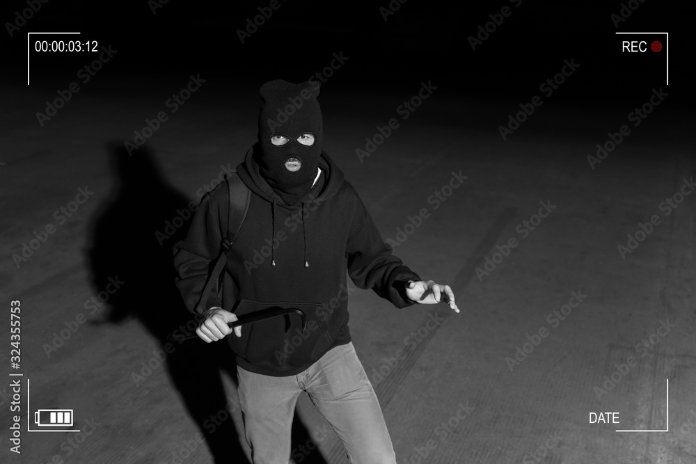 Fototapeta CCTV View Of Thief Standing In Dark Alley