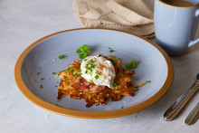 Potato Cake With  Bacon And Poached Egg, Garnished With Spring Onion And Parsley. Vegetable Fritters, Pancakes