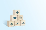 Medical symbols on wooden blocks. Medical and pharmaceutical concept. Medical treatment and public health problems. Signs from medicine on a light background.