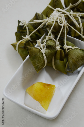 In making zongzi, alkaline water turns the flavor slightly astringent and changes the color light yellow Wallpaper Mural