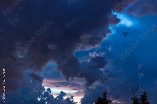 Dark sky on sunset. Big clouds before rain. #324409336