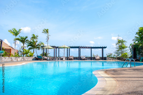 Fototapeta landscape swimming pool blue sky with clouds. Tropical beautiful hotel in thailand. obraz