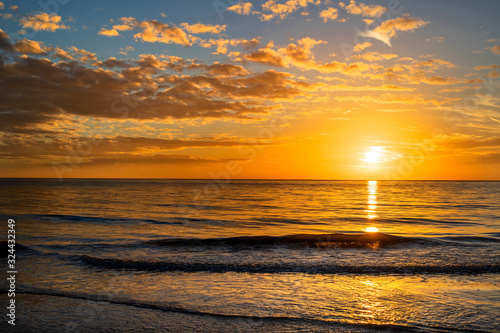 Beautiful Golden Sunset Beach Waves