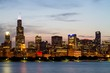 Beautiful view of Chicago skyline with waterfront at twilight, Illinois, USA