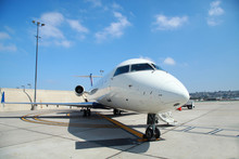 Small Commercial Plane Parking In Sunny Day
