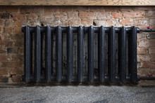 Black Metal Heater On Brick Wall