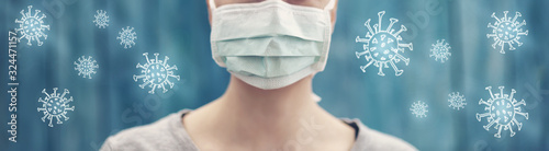 Fototapeta young woman in medical face protection mask indoors on blue background obraz