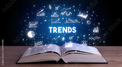 Fototapeta TRENDS inscription coming out from an open book, business concept obraz
