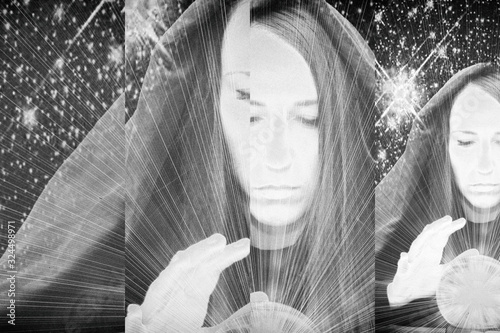 Photo A young woman with a large round crystal on the background of the starry sky