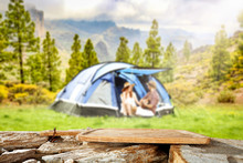 Desk Of Free Space And Blurred Landscape Of Camping
