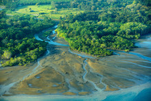 River In Tropic Costa Rica, Corcovado NP. Lakes And Rivers, View From Airplane. Green Grass In Central America. Trees With Water In Rainy Season. Photo From Air.