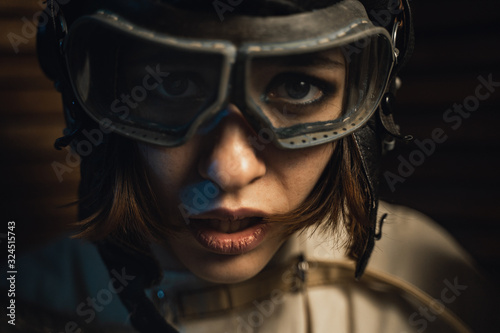 Mad Woman In A Straitjacket And A Pilot Helmet With Glasses Fotobehang