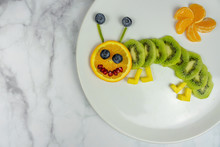 Funny Fruit Worm On White Plate Healthy Dessert For Kids