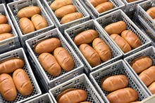 Storage And Transport Of Freshly Baked Loaves Of Bread In A Bakery For Sale - Industrial Food Production