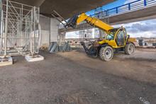 Telehandler On A Construction Site, Preparing To Raise Construction Parts