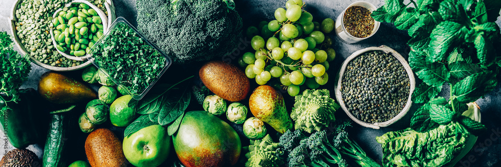 Fototapeta Variety of Green Vegetables and Fruits on the grey background, banner size