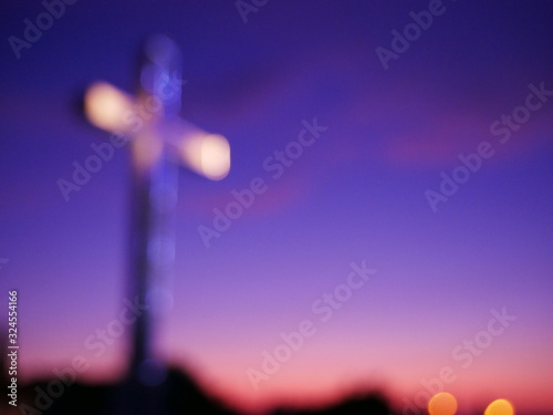 Valokuvatapetti Abstract religious cross, with sunset in the background